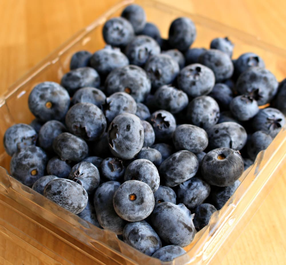 Blueberries in a plastic container.
