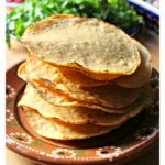 Tostadas are corn tortillas that are usually baked or fried. They become crispy and crunchy. Then, they get topped with refried beans, chicken, ground beef, or anything your heart desires. Talk about delicious Mexican food! By Mama Maggie's Kitchen