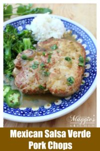 Chuletas de Puerco en Salsa Verde (Salsa Verde Pork Chops) in a blue plate next to rice and broccoli.
