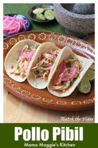 Pollo Pibil (Yucatan Style Chicken) tacos on a clay plate topped with Mexican pickled onions.