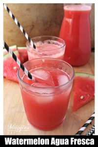 Watermelon Agua Fresca glasses with straws.