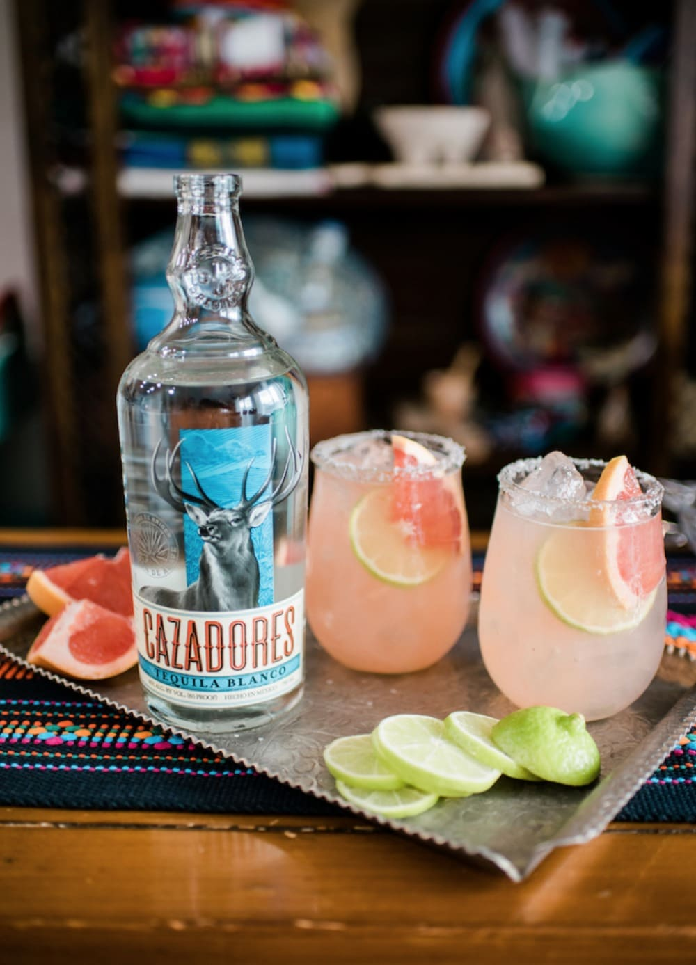 Highland Margarita next to a bottle of Cazadores Tequila.