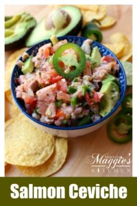 Salmon Ceviche in a blue bowl topped with a jalapeno slice.