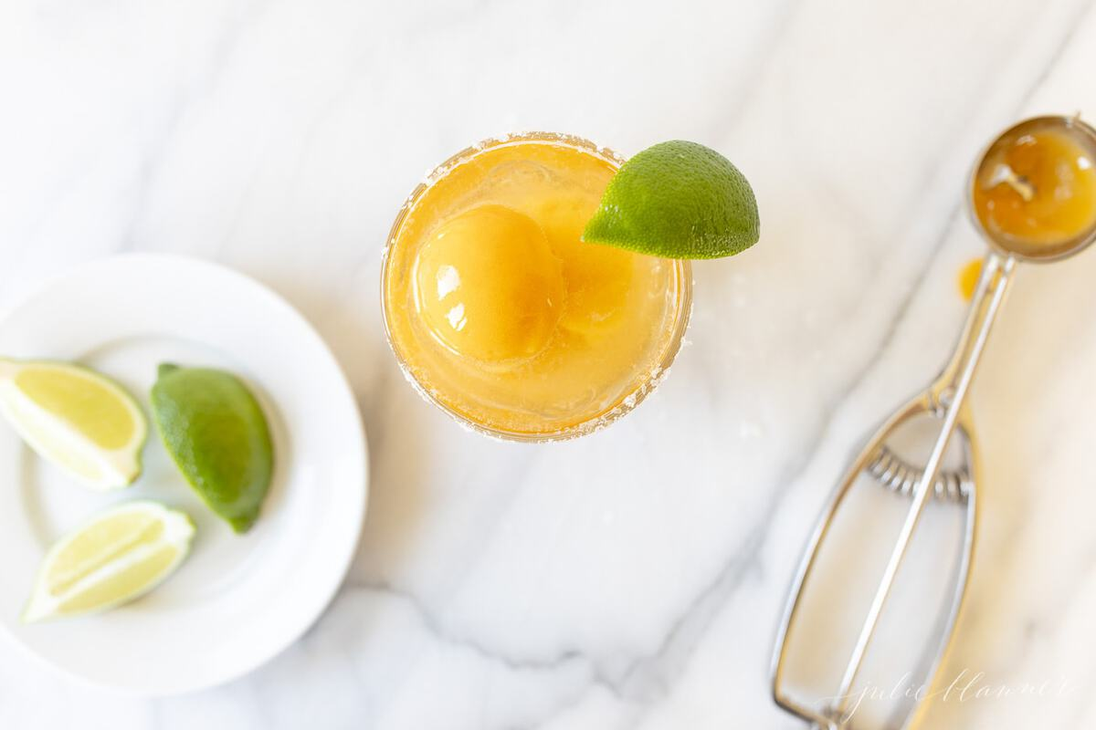 Mango Margarita served with a dollop of mango sorbet.