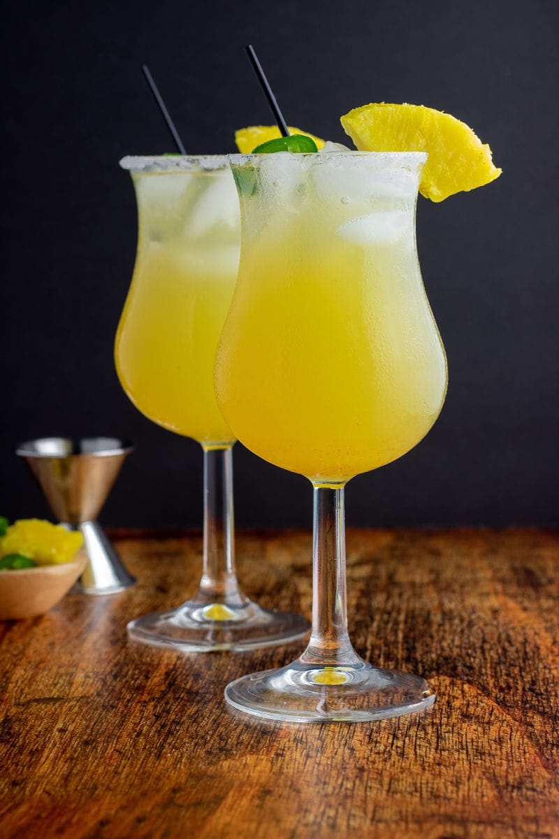 Sweet Hot Mama Cocktails topped with lime and pineapple wedges.