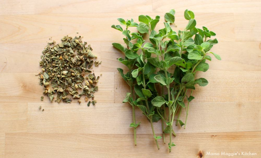 Dried Mexican oregano next to a bundle of fresh oregano.