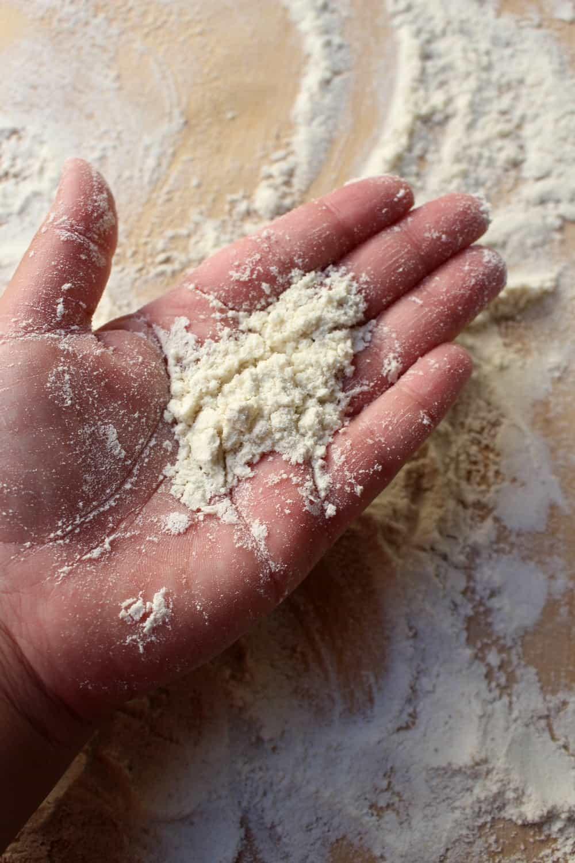 A hand holding masa harina.