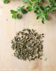 Dried Mexican oregano next to fresh oregano.