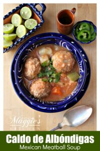 Mexican Albondigas Soup in a decorative blue bowl topped with cilantro.