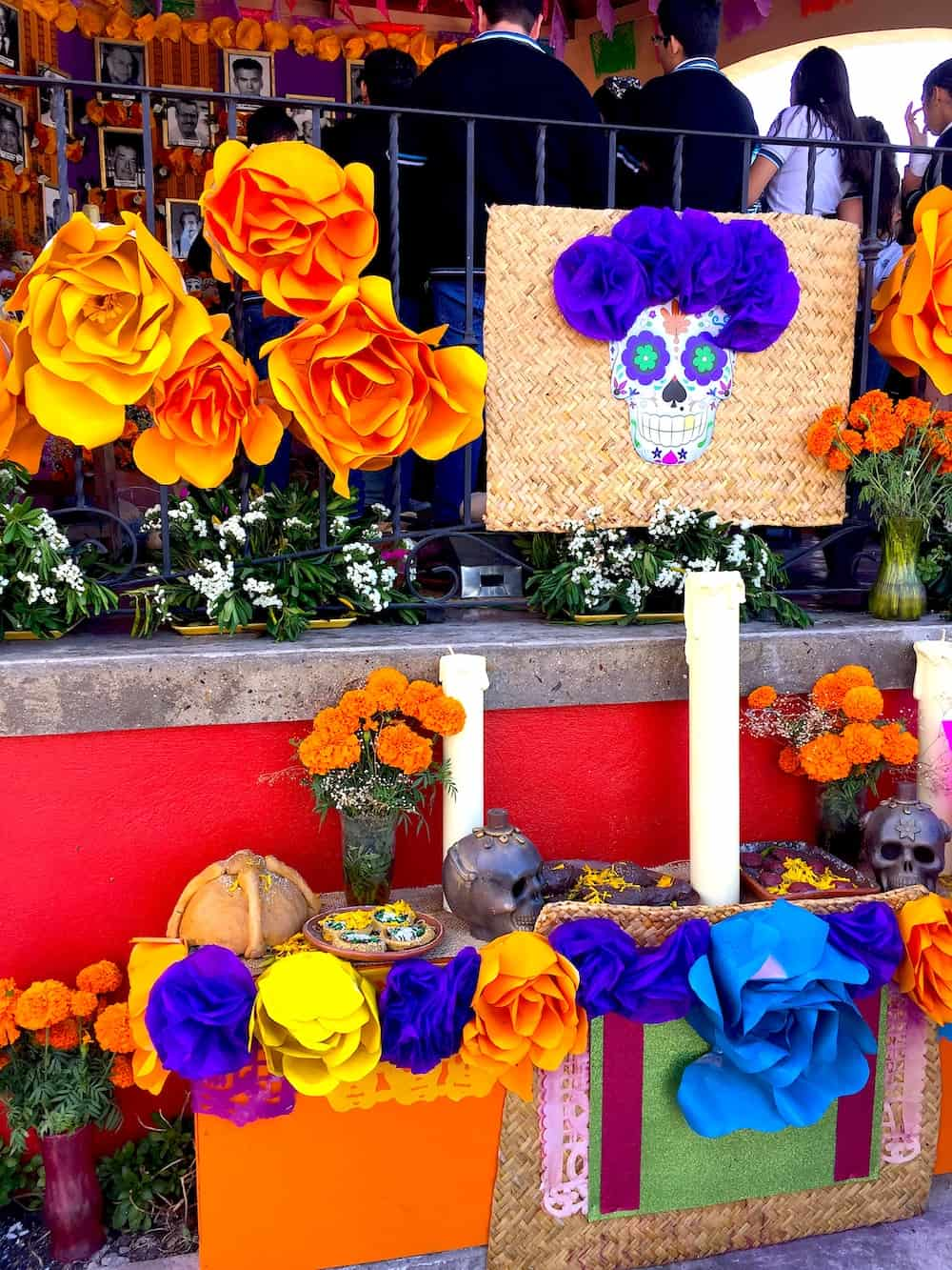 Paper flowers and marigolds decorate a Day of the Dead Altar.