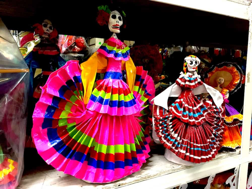 Miniature Catrina dolls wearing traditional Mexican folklorico dress.