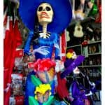 An image of La Catrina with a blue hat.