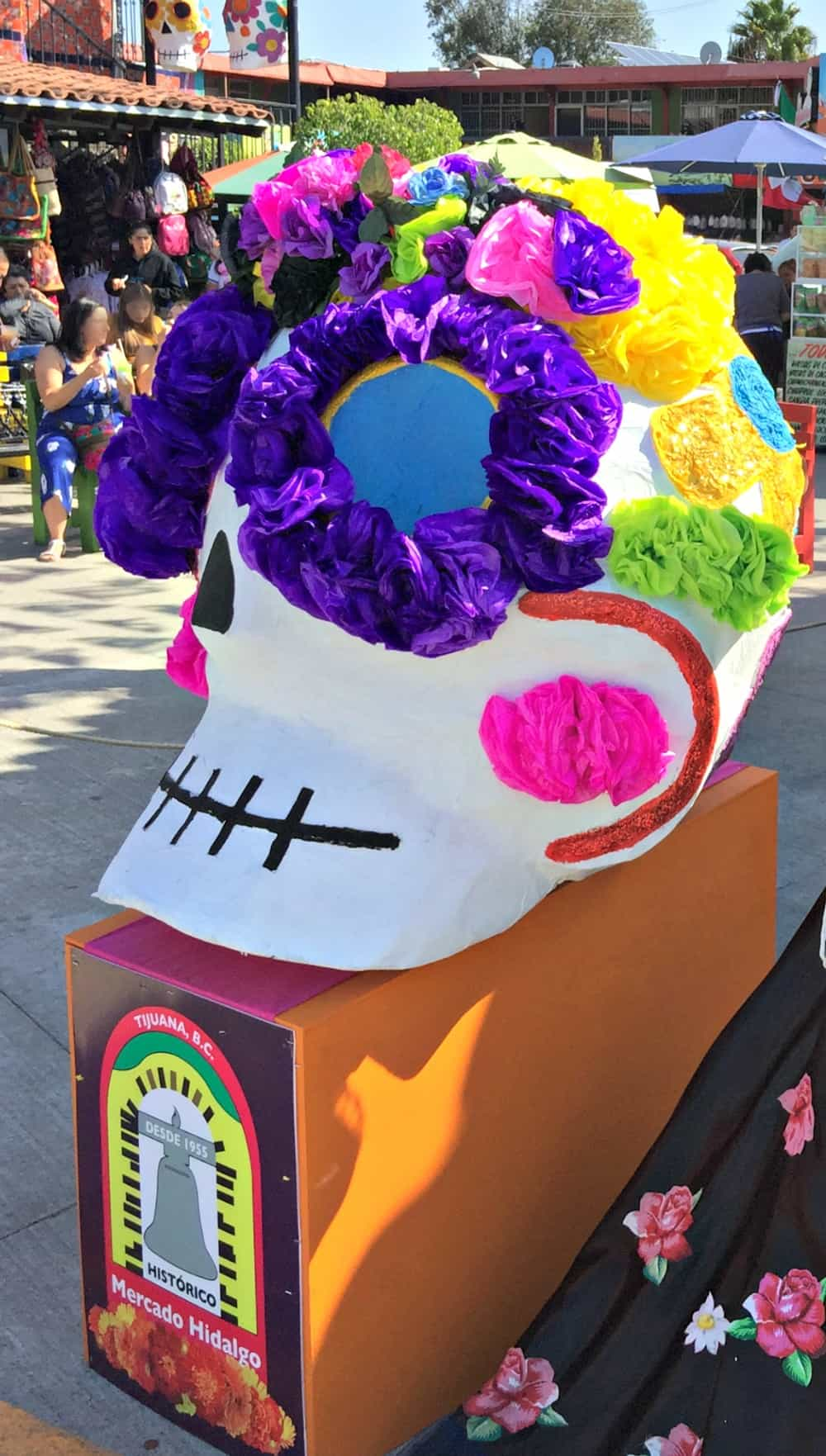 A large statue of a skull ornately and colorfully decorated.