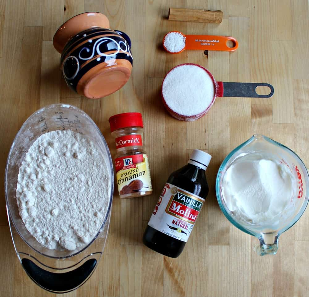 Ingredients for hojarascas cookies on a wooden surface.