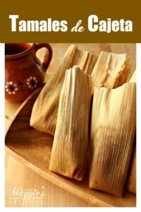 Tamales de Cajeta on a wooden platter next to a decorative mug.