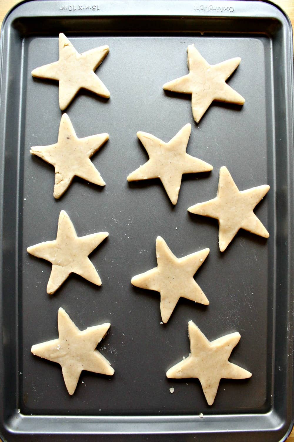 Star-shaped cookies on a cookie sheet.