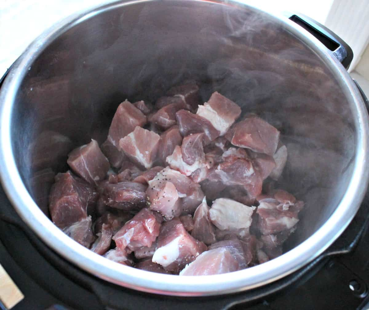 Pork meat cooking inside the instant pot.