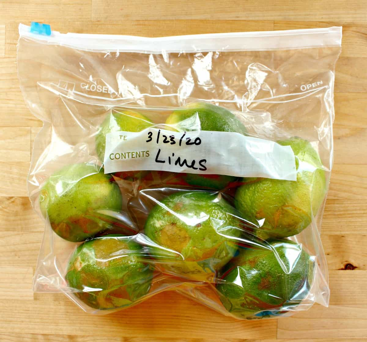 Limes in a plastic bag that is labeled and with the air removed.