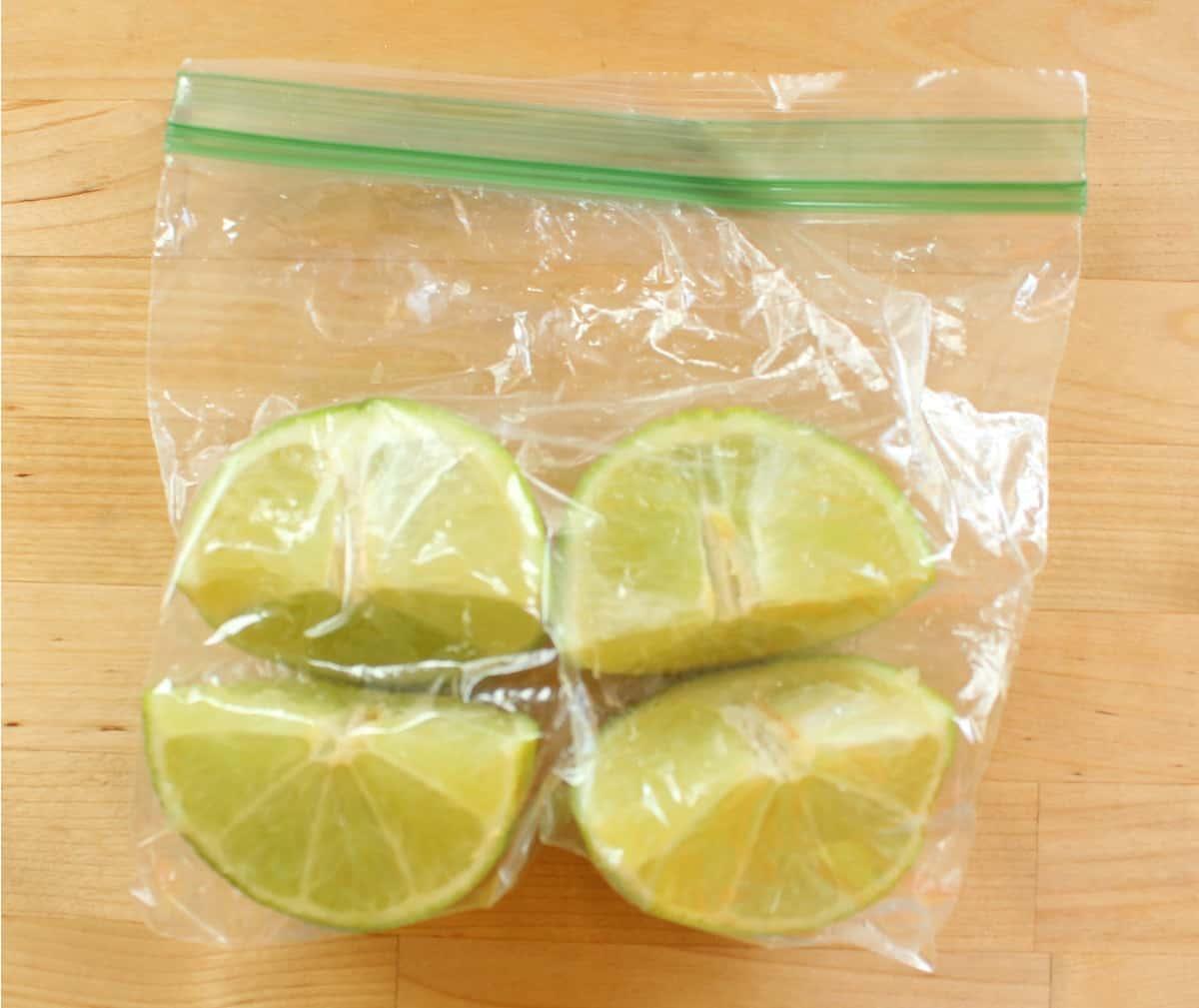 Lime wedges in a plastic bag with the air removed.