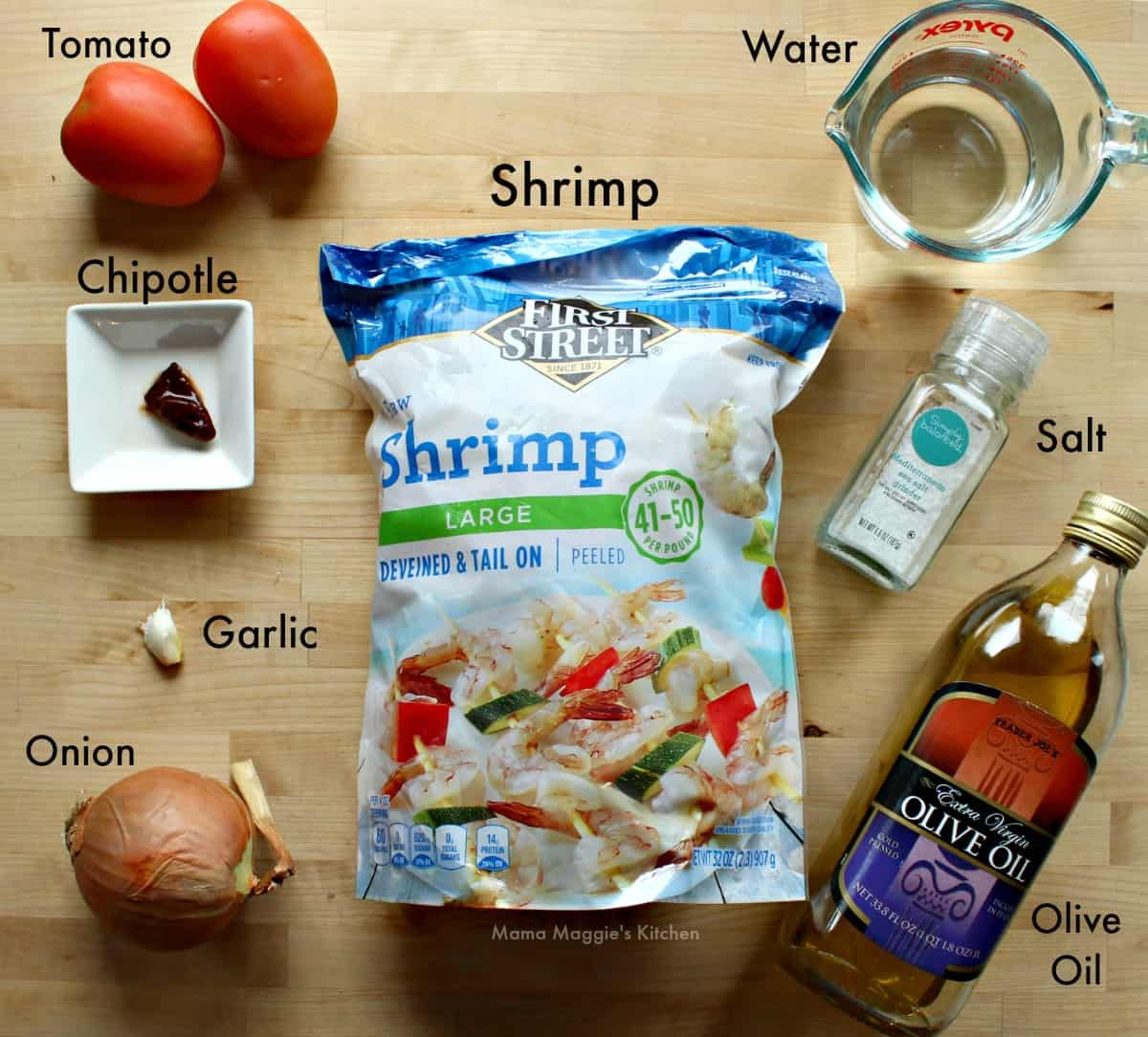 Ingredients for Camarones Enchipotlados on a wooden surface.