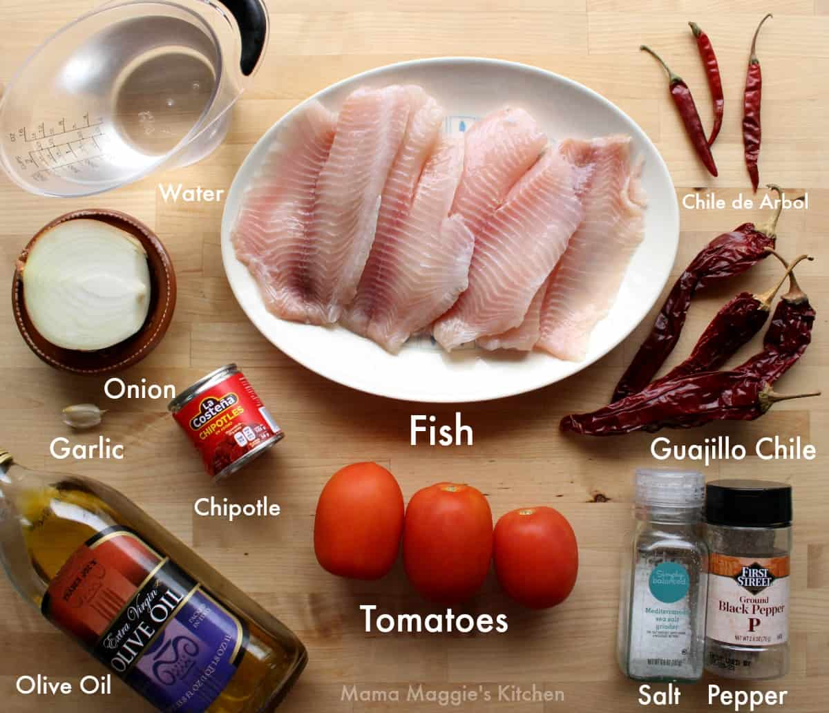 The ingredients to make Pescado a la Diabla labeled and on a wooden surface.