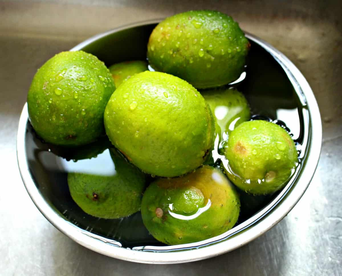 Limes washing in a bowl.