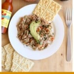 Atún a la Mexicana topped with avocado and served with saltine crackers and hot sauce.