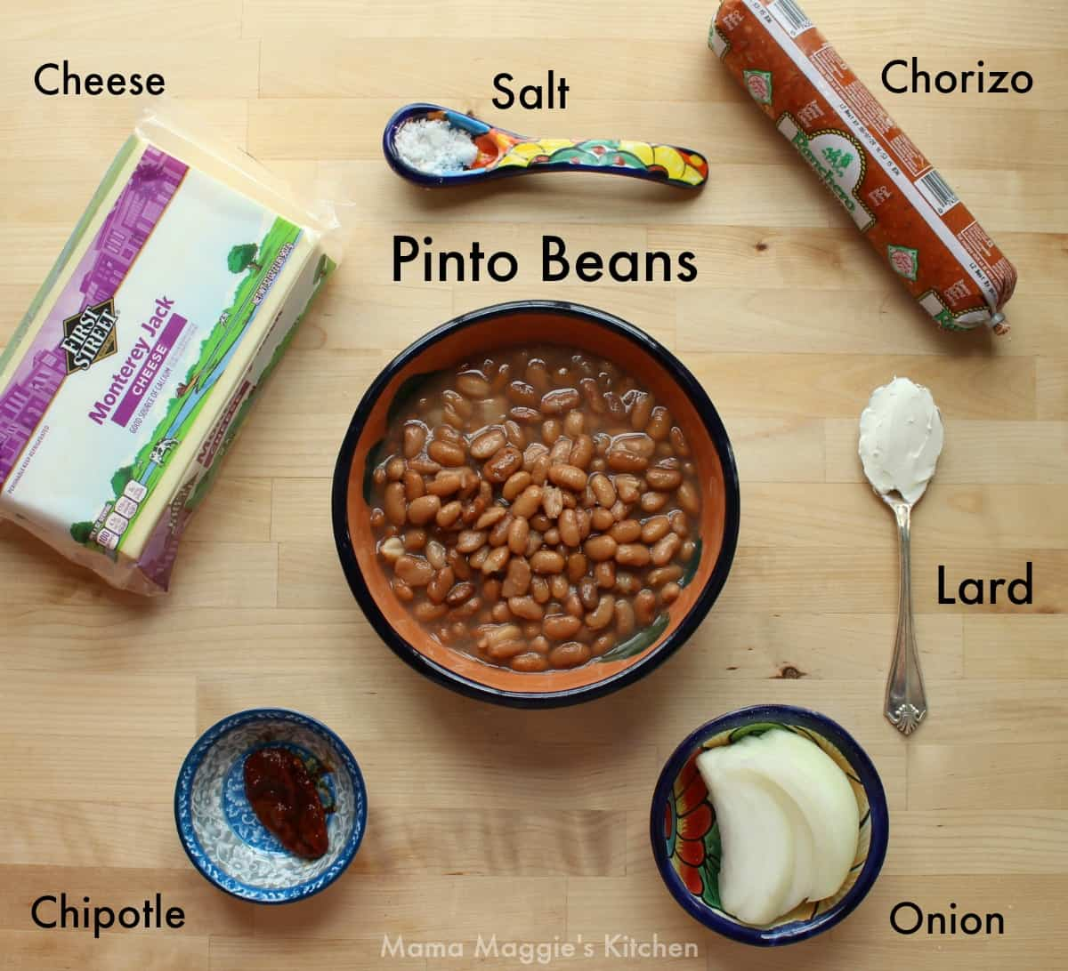 The ingredients for frijoles puercos on a wooden surface.