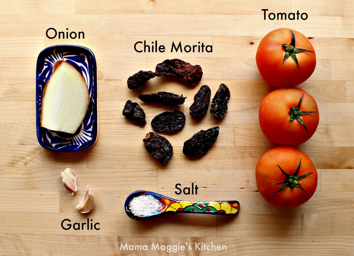 The ingredients for salsa morita on a wooden surface.