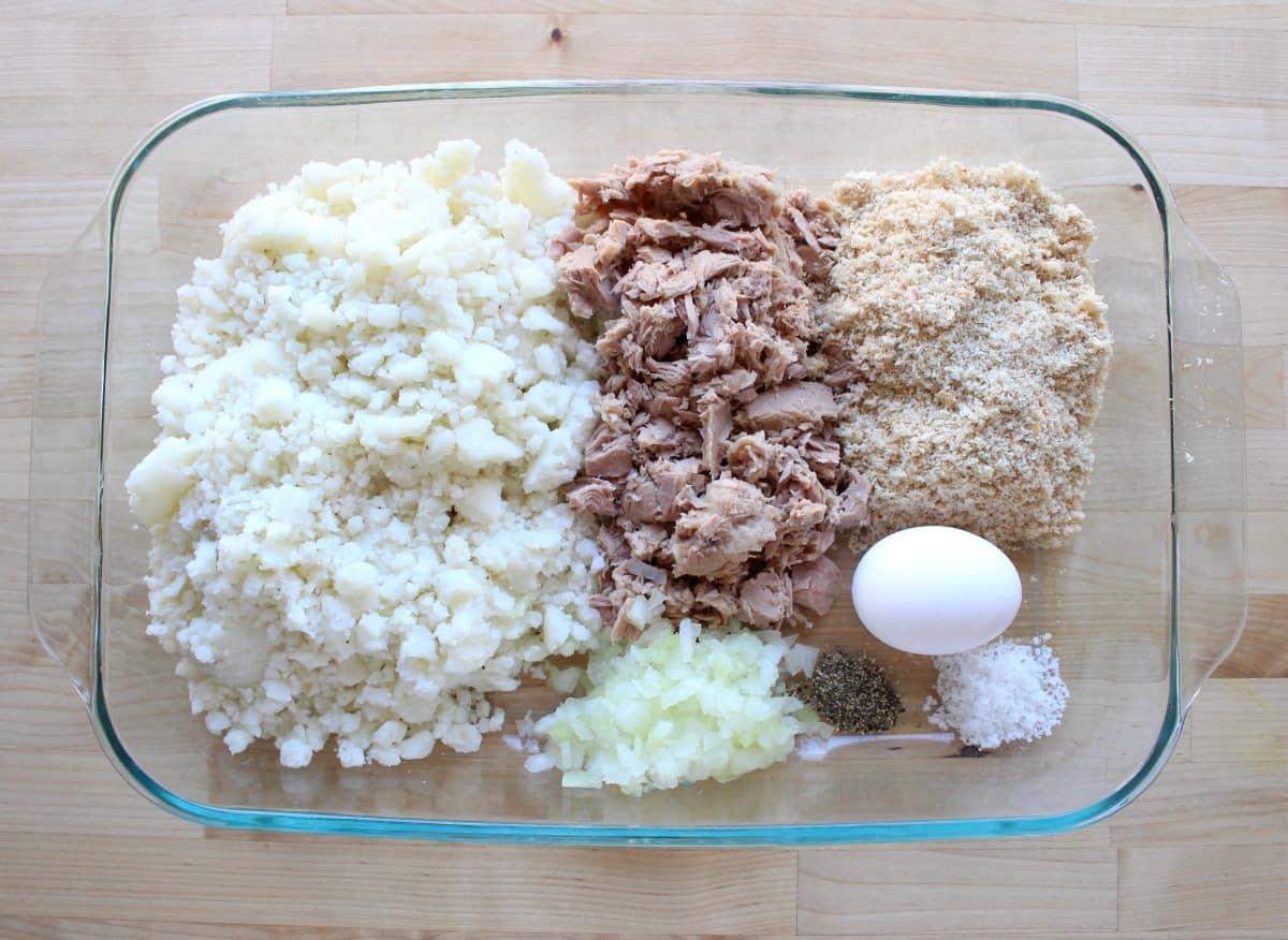 The ingredients to make Tortitas de Papa con Atun in a large baking dish.