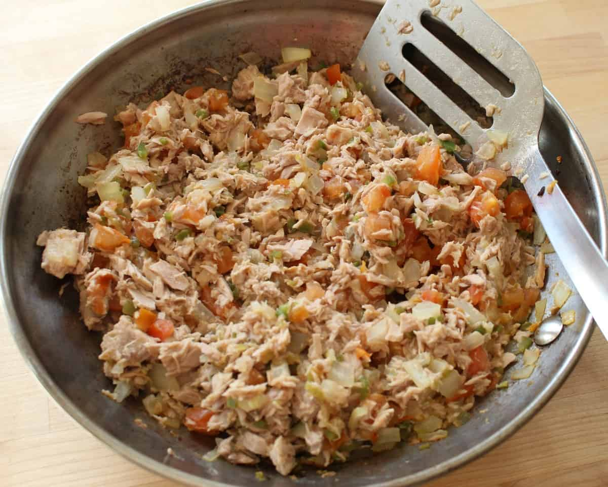 A skillet and spatula with cooked Mexican-Style tuna.