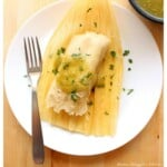 Vegetable Tamal topped with salsa verde and chopped cilantro.