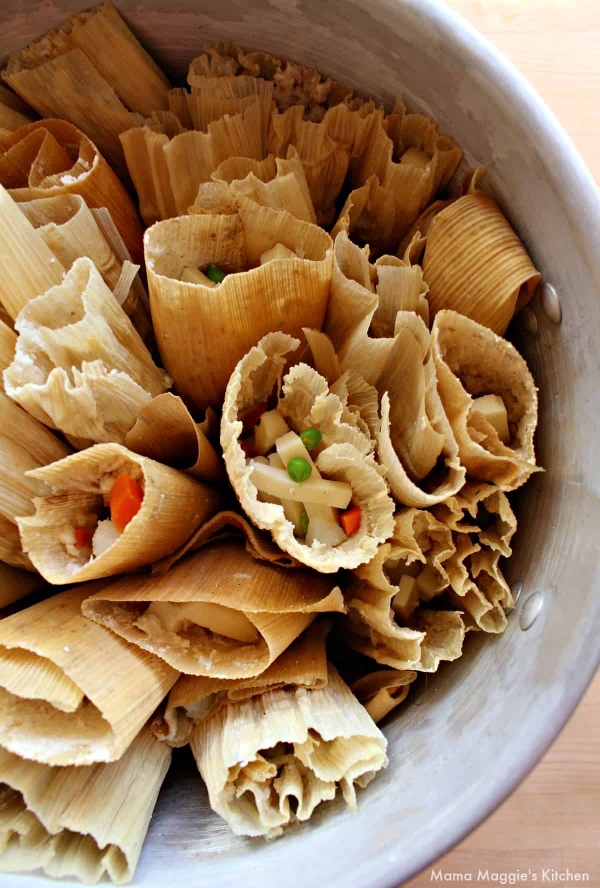 Uncooked tamales assembled in a steamer pot.