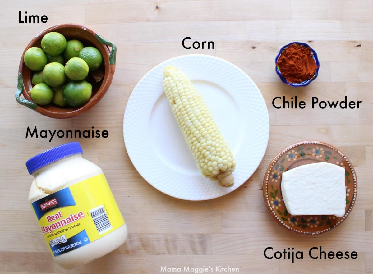 The ingredients for Mexican Street Corn laid out on a wooden surface.