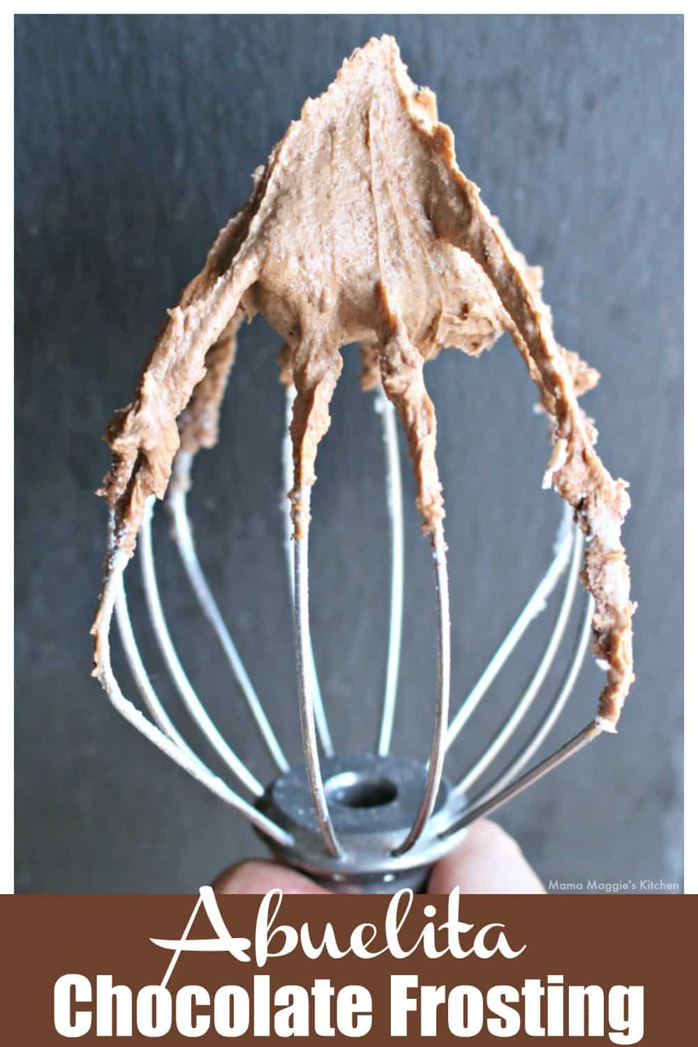 A mixer attachment covered in Abuelita Chocolate Frosting.