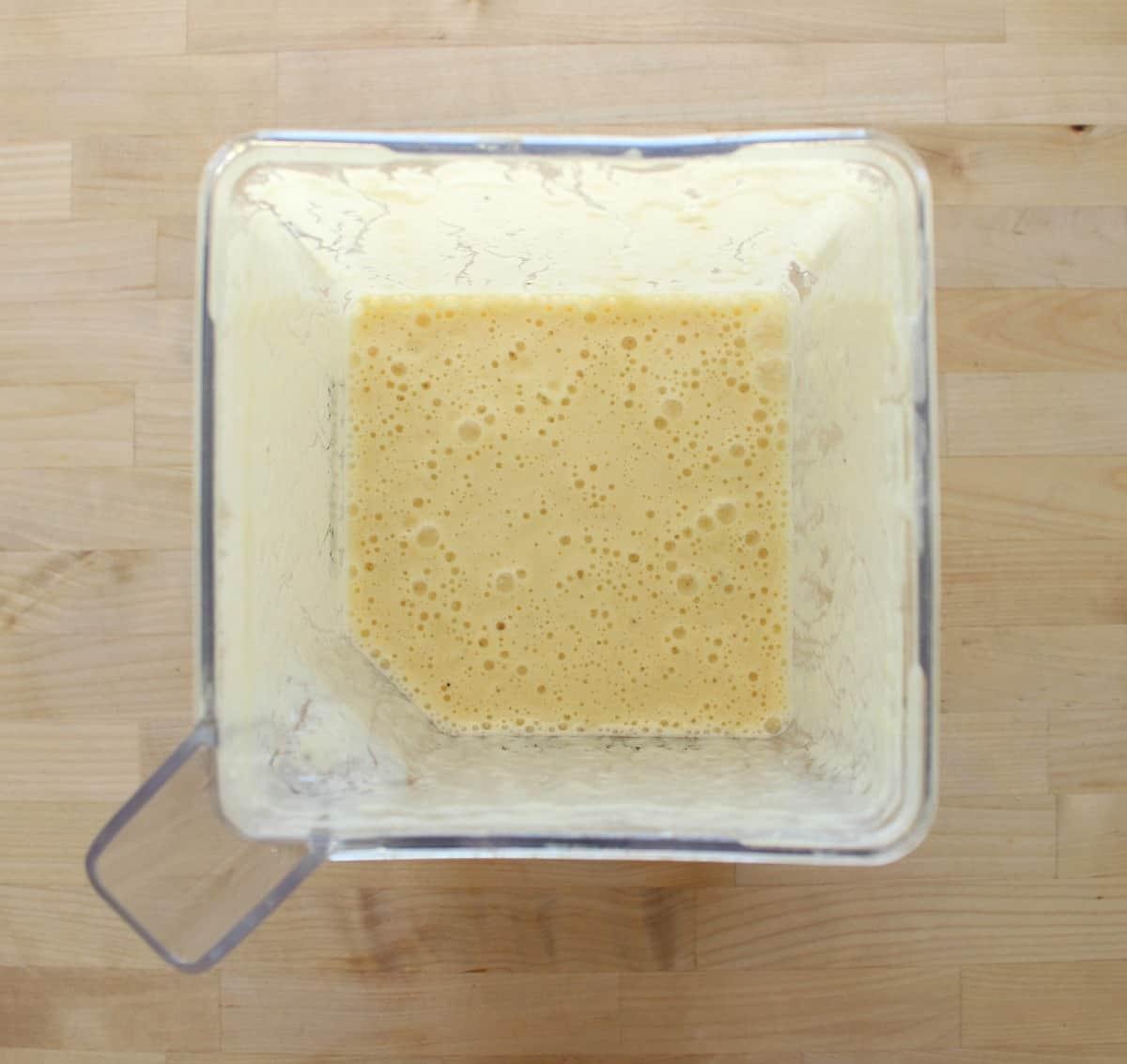 Pineapple banana agua fresca in a blender.