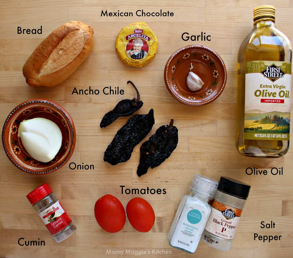 The ingredients necessary to make mole on a wooden surface.