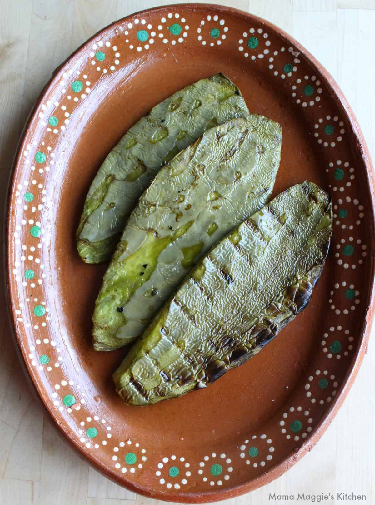 Grilled cactus on a decorative clay Mexican plate.