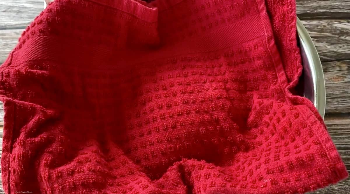 A bowl covered with a red towel.