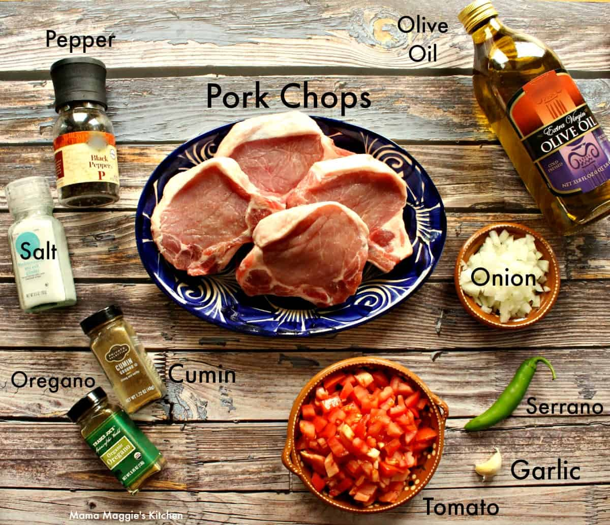 The ingredients necessary to make the pork chops recipe laid out and labeled.