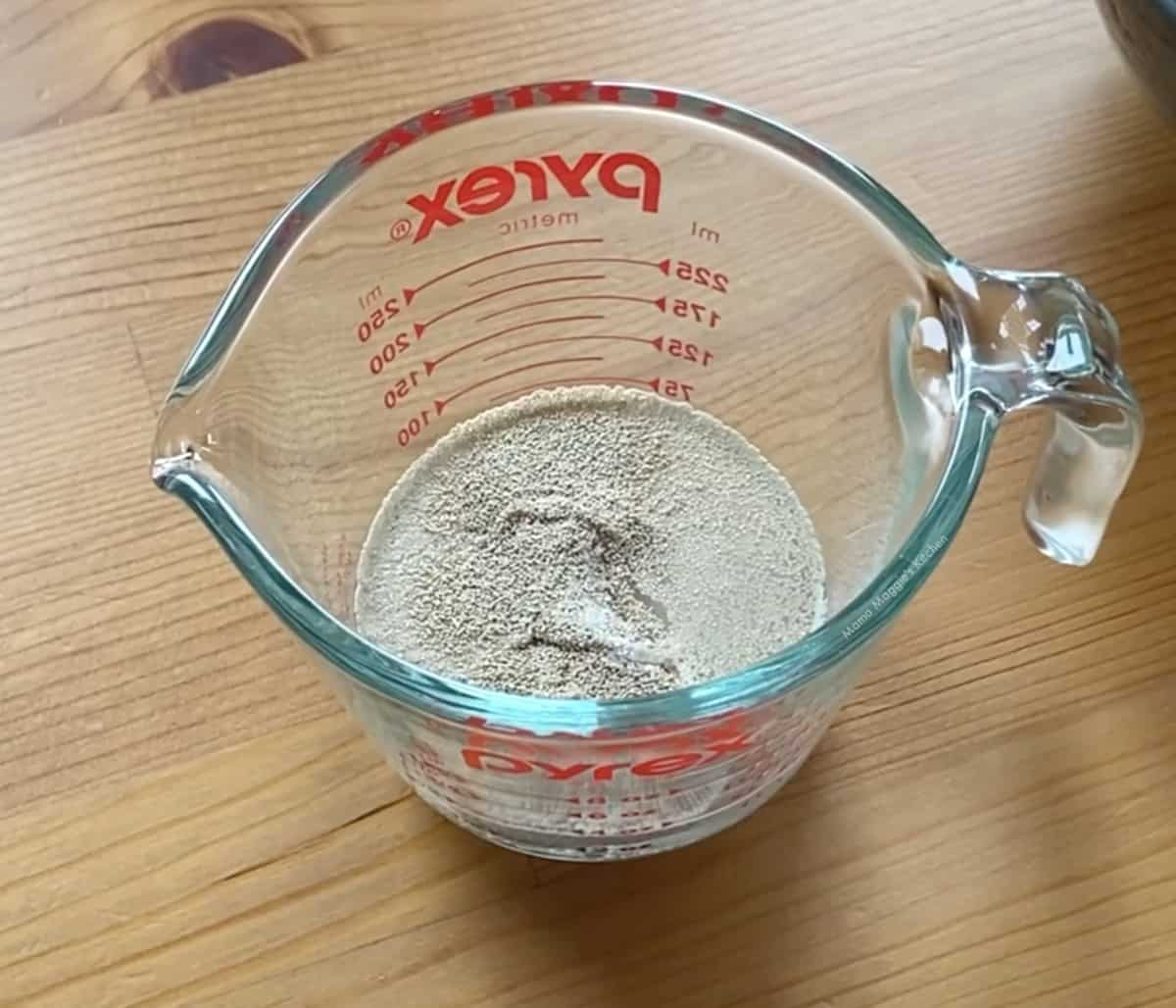 A measuring cut with yeast and water.