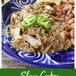 Slow Cooker Ancho Pork on a blue plate served next to beans and tortillas.