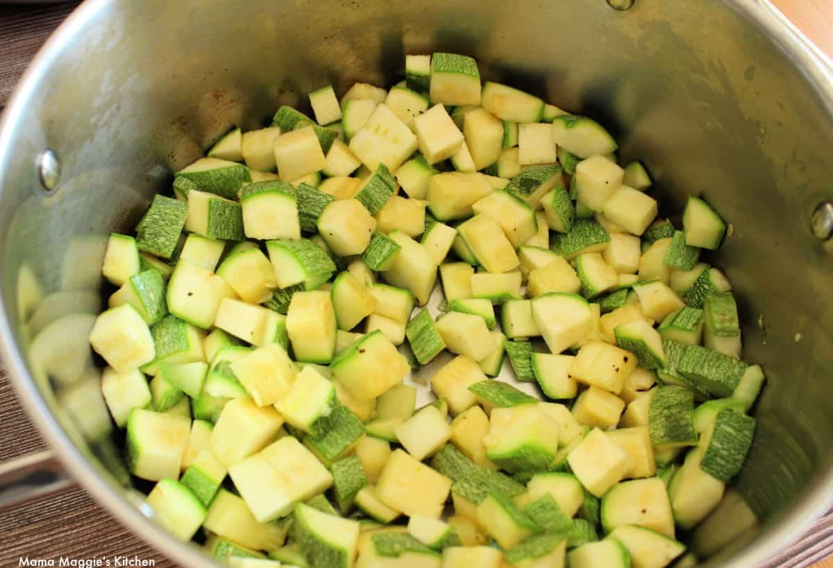 Calabacitas cooking in a metal stock pot.