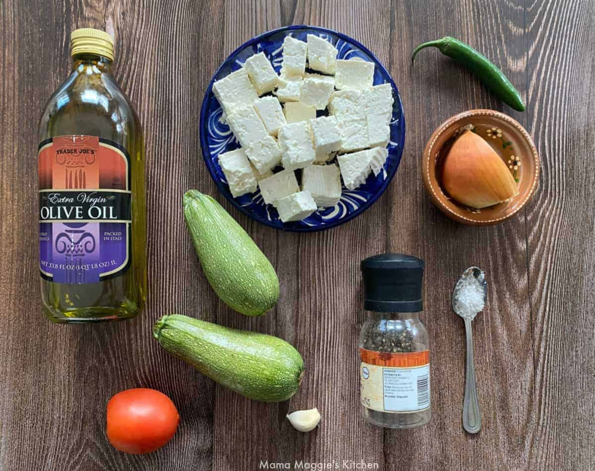 The ingredients necessary to make this dish on a wooden table.