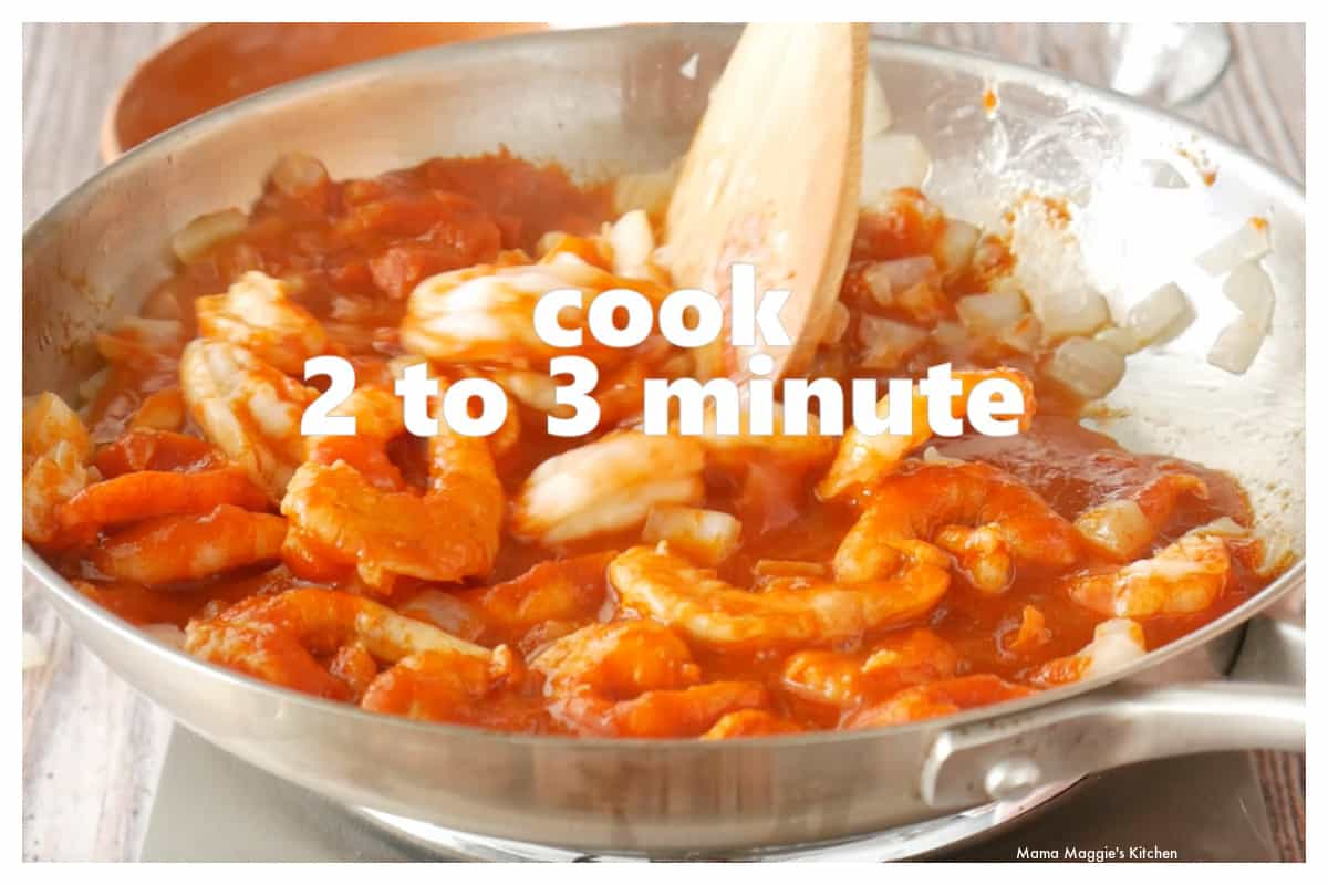 Shrimp cooking in a skillet with the diabla sauce.