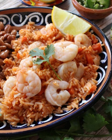 Arroz con Camarones (Mexican Shrimp and Rice) served next to beans and a jalapeno.