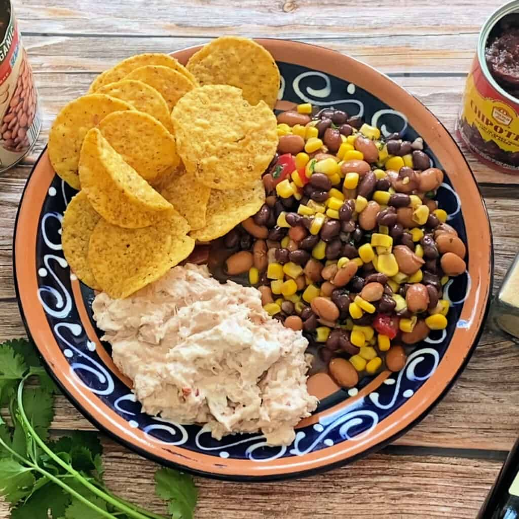 A plate with bean dip and creamy chipotle tuna salad.