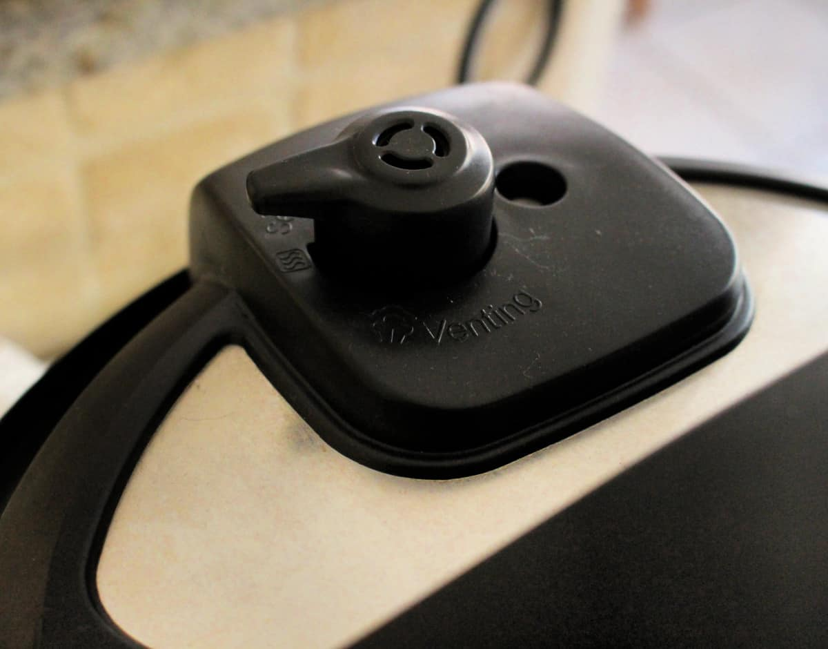 A picture of the venting valve located on the top of a instant pot.