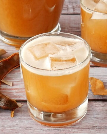 A glass full of ice and Agua de Tamarindo.