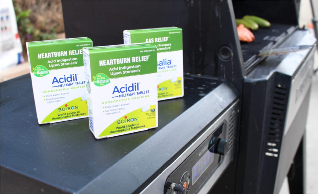 Boiron Acidil boxes sitting on the side of a grill.